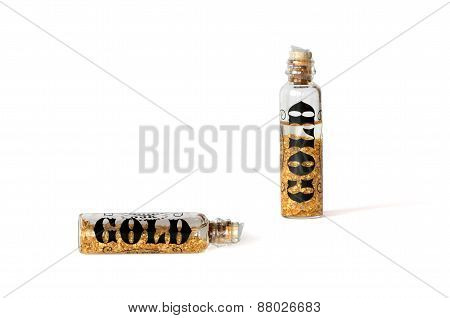Bottles Of Golden Particles