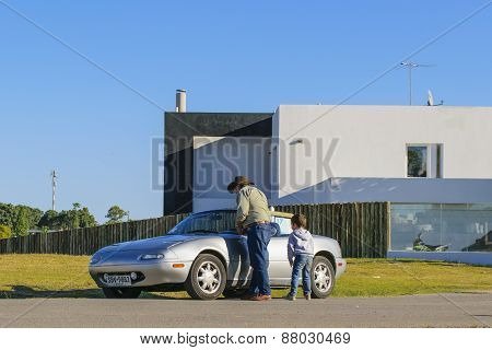 Grandfather And Grandson In Modern Car