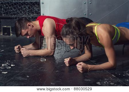 fit sportive man and woman doing plank core exercise training back press muscles concept gym sport s