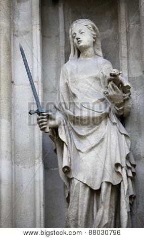VIENNA, AUSTRIA - DECEMBER 11: Saint Justine of Padua, portal of the Minoriten kirche in Vienna, Austria on December 11, 2011.