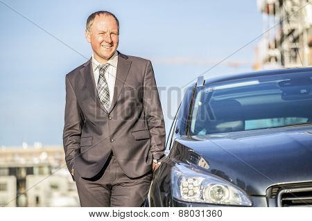 Successful Young Man With Limousine