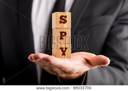Three Wooden Cubes Stacked On The Palm Of Officers Hand Reading Spy