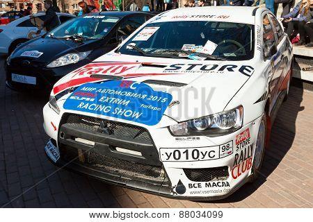 White Mitsubishi Lancer Car Stands Parked