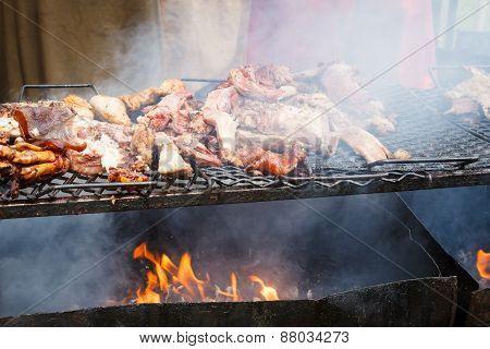 Pork meat grilled in open fire