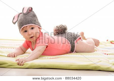 Baby Girl In Knitted Bunny Costume