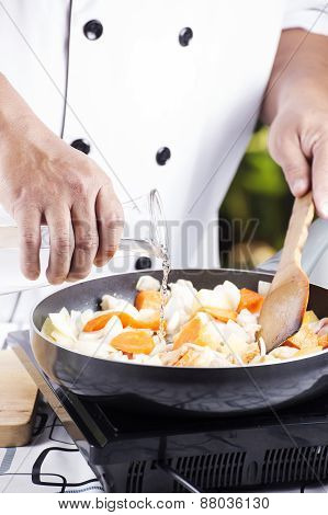 Chef Pouring Soup To The Pan For Cooking Japanese Pork Curry