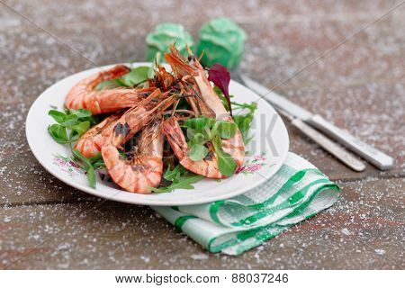 Grilled shrimps served outdoor in winter, snow on table