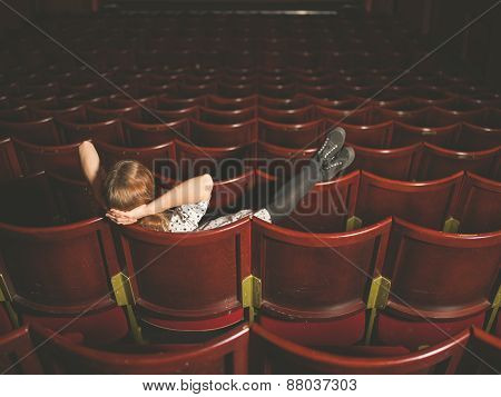 Young Woman Sitting In Auditorium