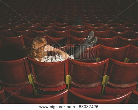Woman Talking On Phone In Auditorium