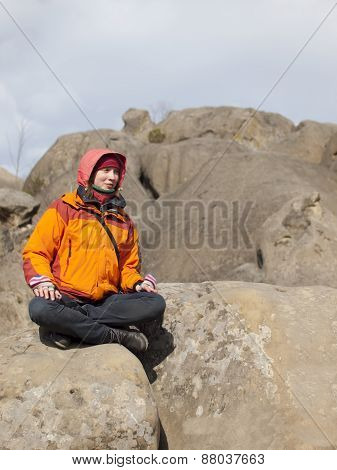 Girl Sitting On A Mountain.