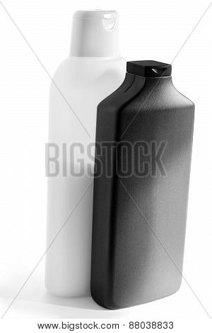 White And Black  Plastic Bottles With Shampoo And Mask For Hair