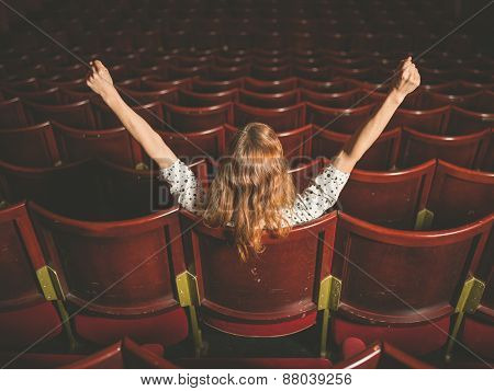Excited Woman In Auditorium