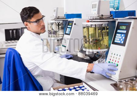 Concentrated scientist working with computer in laboratory