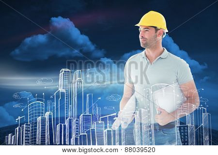 Architect with plan against green field under blue sky