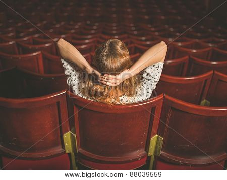 Rear View Of Woman In Auditorium