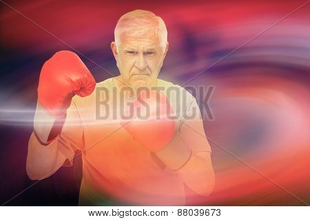 Portrait of a determined senior boxer against sunrise sky