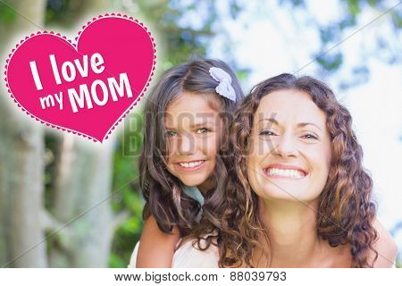 mothers day greeting against happy mother and daughter embracing