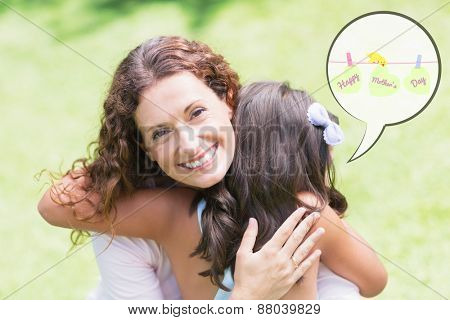 mothers day greeting against happy mother and daughter hugging
