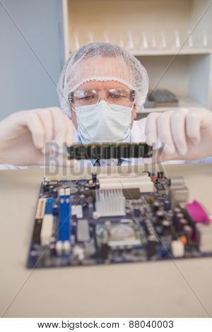 Engineer working on broken cpu in the laboratory