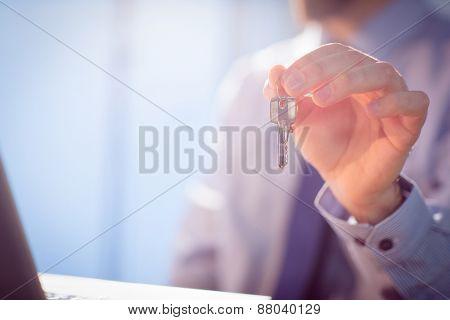 Businessman showing a key shot in studio