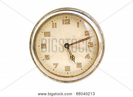 Antique clock face showing the time isolated on a white background
