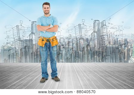 Portrait of happy repairman standing arms crossed against new york skyline