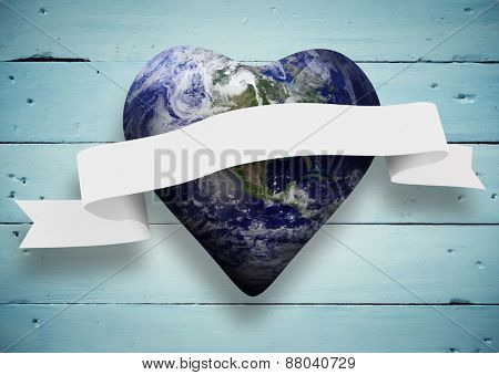 Heart shaped earth with scroll against painted blue wooden planks