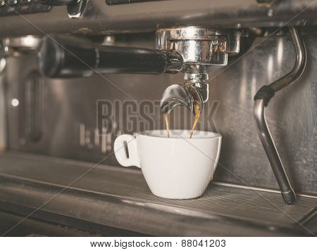 Coffee Machine And A Small White Cup