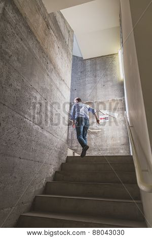Guy Climbing The Stairs At Ventura Lambrate Space During Milan Design Week