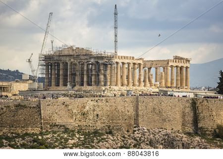 ATHENS, GREECE - APR 7, 2015: Parthenon temple on the Acropolis hill. Parthenon is a former temple on the Athenian Acropolis, dedicated to the goddess Athena. Construction began in 447 BC.