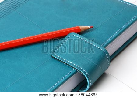 Notebook  With Red Penci