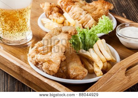 Fish And Chips With Tartar Sauce On A Tray