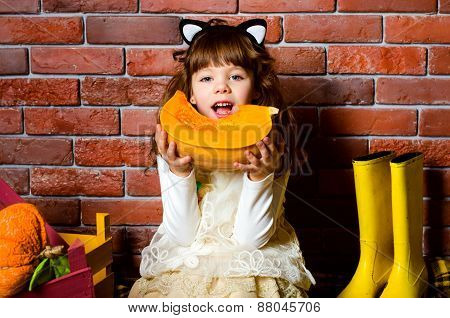 Girl Eating A Pumpkin