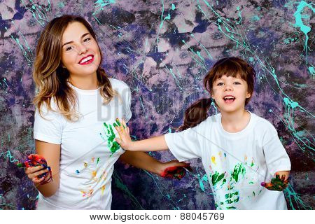 Mother Together With A Daughter Is Shown With Palms Soiled With