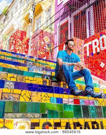 RIO DE JANEIRO - CIRCA NOV 2014: Tourist at Escadaria Selaron in Rio de Janeiro, Brazil. The stairway is famous work of Chilean artist Jorge Selaron.