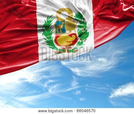 Peruvian waving flag on a beautiful day