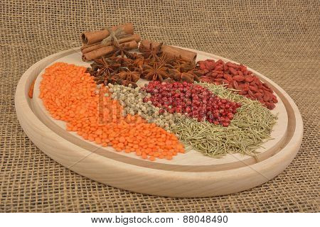 Different Spices On Wooden Background.