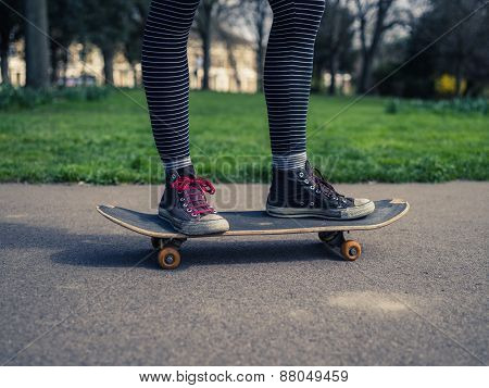Legs Of Person Skateboarding In The Park