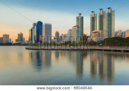 Bangkok city at twilight with reflection of skyline
