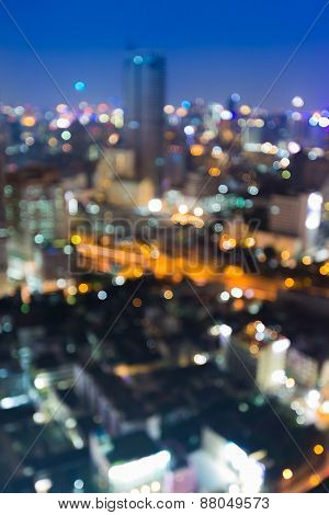 Bokeh city lights blurred background effect during twilight