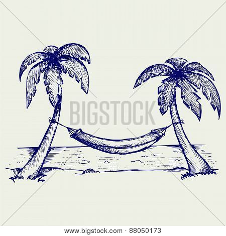 Romantic hammock between palm trees
