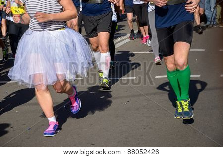 Marathon running race, women runners feet on road