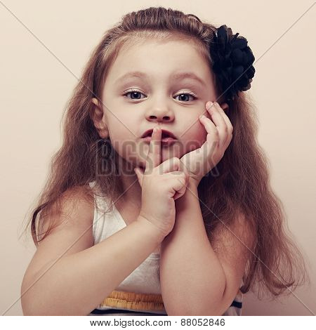 Cute Small Kid Showing Silent Sign The Finger Near Lips. Vintage Portrait