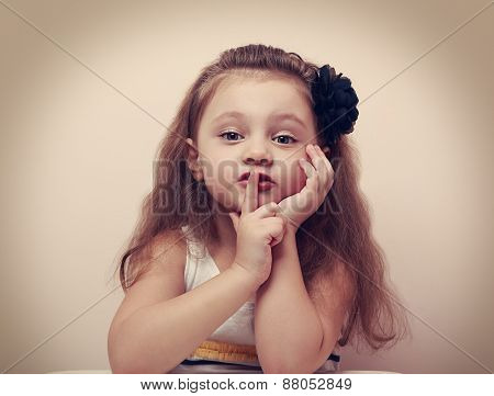 Cute Kid Girl Showing Silence Sign The Finger Near Lips. Vintage