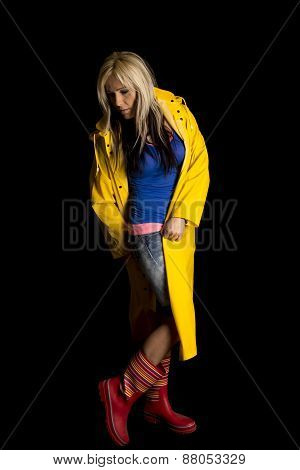 Woman In A Yellow Rain Coat Full Body On Black