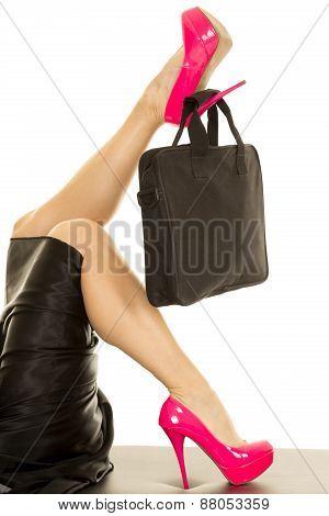 Woman Legs In Pink Heels With Black Bag On Upper Leg