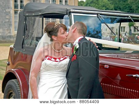 Kissing In Front Of Wedding Car
