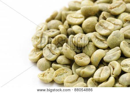 green (white) coffee beans on white background