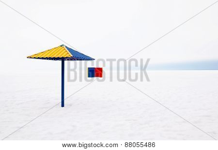 Dressing cabin and umbrella on the beach