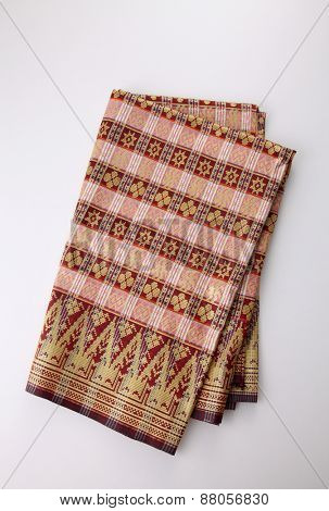 Malaysia Songket .Songket is a fabric that belongs to the brocade family of textiles of Indonesia, Malaysia and Brunei. It is hand-woven in silk or cotton